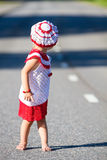 Playful toddler girl on road Royalty Free Stock Photo