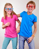 Playful twin brother and sister have fun Stock Photos