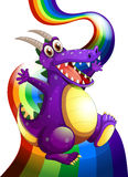 A playful violet dragon and a rainbow Stock Image