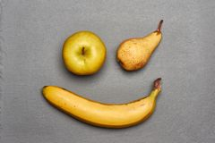 Playful winking smile made of yellow fruits Stock Photography