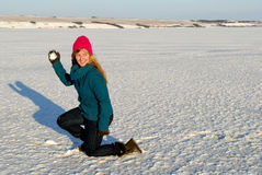 Playful Winter Woman with Snowball Stock Image