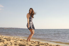 Playful woman on beach Stock Photos