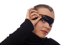Playful woman with black ribbon on eye Stock Photo