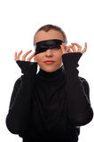 Playful woman with black ribbon on eyes Royalty Free Stock Photo