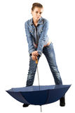 Playful woman in a blue denim suit Stock Photography