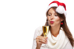 Playful woman celebrating Xmas blowing a kiss Stock Image