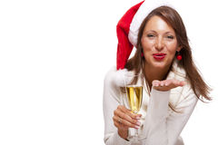 Playful woman celebrating Xmas blowing a kiss Royalty Free Stock Image