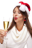 Playful woman celebrating Xmas blowing a kiss Royalty Free Stock Photos
