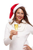 Playful woman celebrating Xmas blowing a kiss Royalty Free Stock Images