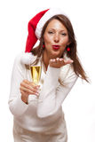 Playful woman celebrating Xmas blowing a kiss Stock Photo