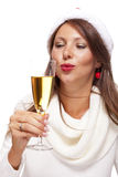 Playful woman celebrating Xmas blowing a kiss Royalty Free Stock Photography
