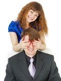 Playful woman covered eyes of man Royalty Free Stock Image