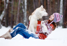 Playful woman with dog. On snow Stock Photo