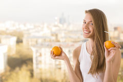 Playful woman drinking orange juice stock photography