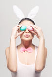 Playful woman with easter eggs Stock Images
