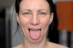Playful woman sticking out her tongue royalty free stock photos