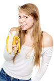 Playful woman holding banana Royalty Free Stock Images