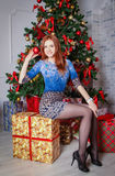 Playful woman holding ornament Stock Photography