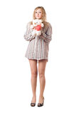 Playful woman holding teddy bear Stock Images