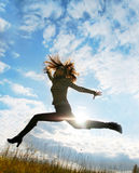 Playful woman jumping Stock Images