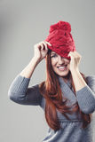 Playful woman in a knitted red beanie Stock Photography