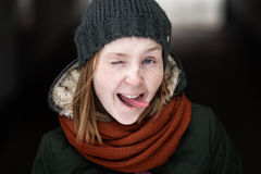 Playful woman in knitted winter cap smiling Stock Photos
