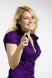 Playful woman pointing at the viewer Stock Photo