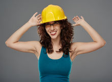 Playful woman with protection helmet Stock Photography