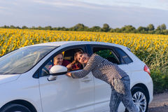 Playful Woman Pulling the Hair of a Female Driver Stock Photography