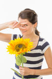 Playful woman with sunflower Royalty Free Stock Images