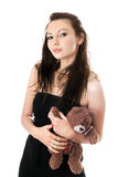 Playful woman taking teddy-bear Stock Images