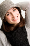 Playful woman, or teen in fall or winter clothing. Headshot of a playful woman, or teen in fall or winter clothing wearing a scarf Royalty Free Stock Photo