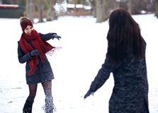 Playful Women Playing in the Snow Outdoors Stock Photos