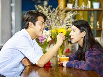 Playful young asian couple in coffee shop Stock Images