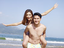 Playful young asian couple Royalty Free Stock Image