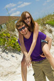 Playful young beach couple Royalty Free Stock Image