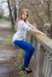 Playful young blond woman Stock Photos