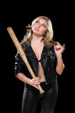 Playful young blonde with a bat stock images