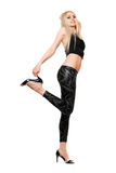 Playful young blonde in black leggings Stock Photo