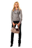 Playful young blonde with a handbag Royalty Free Stock Photo