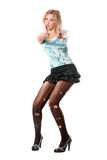 Playful young blonde in torn pantyhose Royalty Free Stock Photography