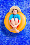 Playful young boy in a summer swimming pool Stock Photo