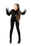 Playful young brunette in gloves with claws Stock Image
