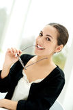 Playful young businesswoman smiling Royalty Free Stock Photos
