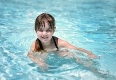 Playful Young Child in the Pool Stock Images