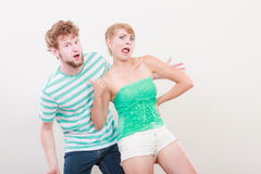 Playful young couple blonde girl bearded man Stock Images