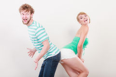 Playful young couple blonde girl bearded man Royalty Free Stock Image