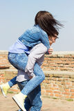 Playful young couple enjoying outdoors stock image