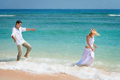 Playful young couple have a fun in tropical sea Royalty Free Stock Photography