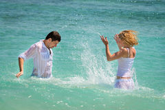 Playful young couple have a fun in tropical sea Stock Photo